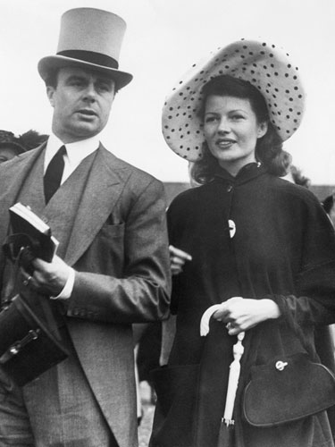 Rita Hayworth and her husband, Prince Aly Kahn, at the races. 1949